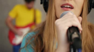 Close-up of woman singing and recording song in studio - HD stock video clip