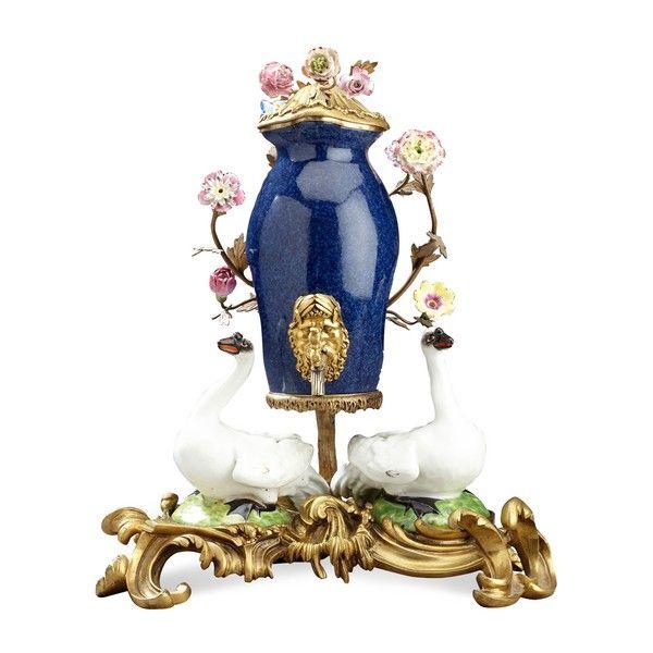 An ormolu mounted Meissen style porcelain table fountain