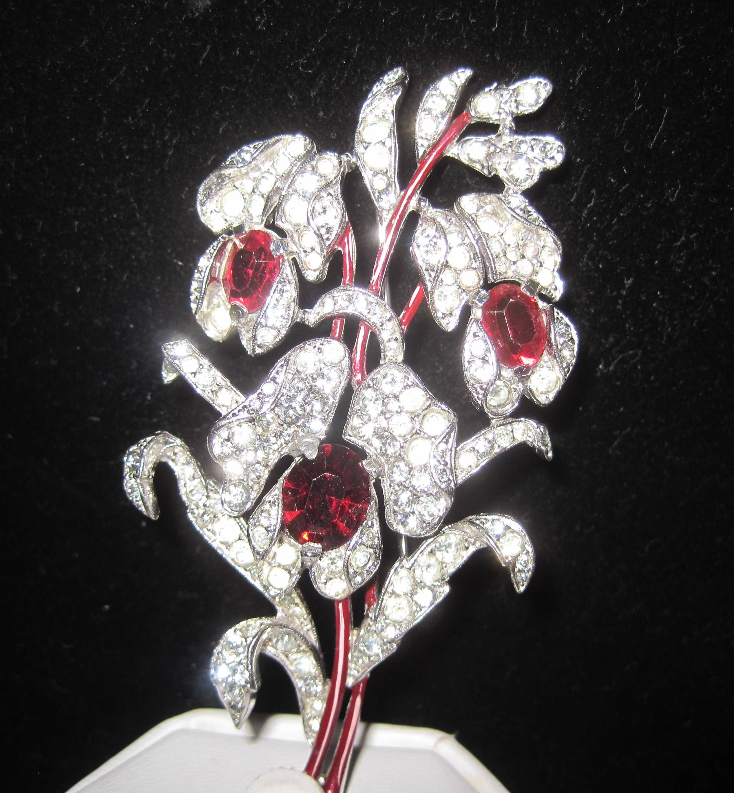 Crown trifari brooch red rhinestone des pat pend this