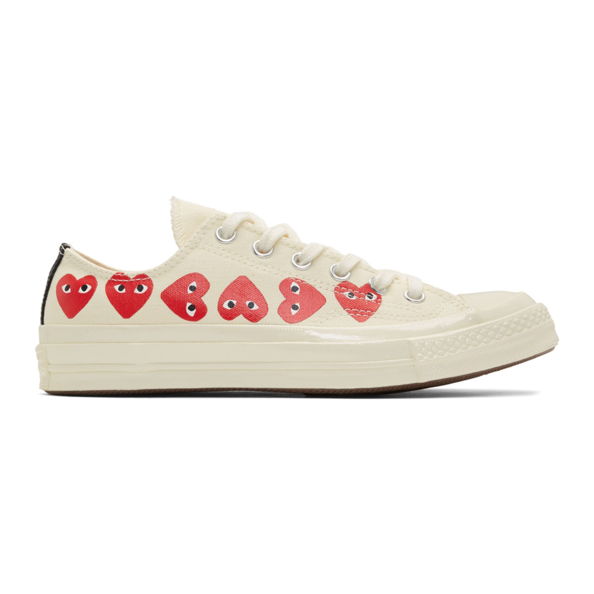 white converse with heart