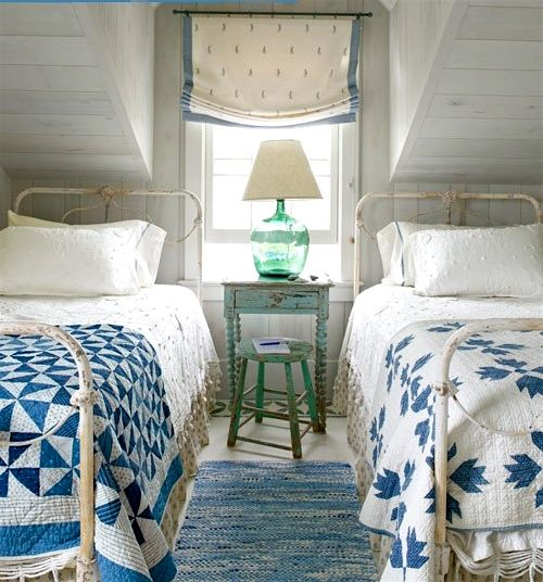 Cozy Coastal Bedroom: Matching Twin Iron Beds In Beach Side Cottage