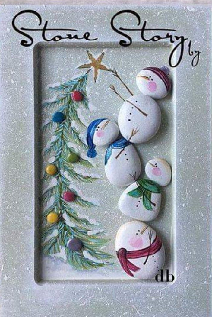 Very cute framed stone snowman with Christmas tree painting. Very cute framed stone snowman with Christmas tree painting.