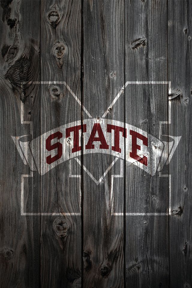 Mississippi State logo on distressed wood background