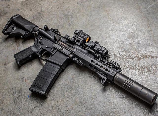 Ar15 With A Suppressor Nice Rifle Weapons Pinterest