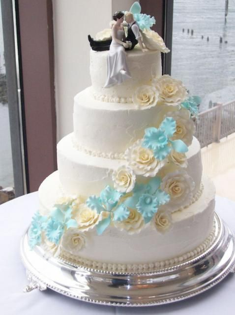 4 Tier White Round Wedding Cake With Cascading Flowers And Best Topper Ever