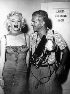 Marilyn with photographer Bruno Bernard at the St. Jude's Children's Hospital charity event at the Hollywood Bowl, July 10th 1953.