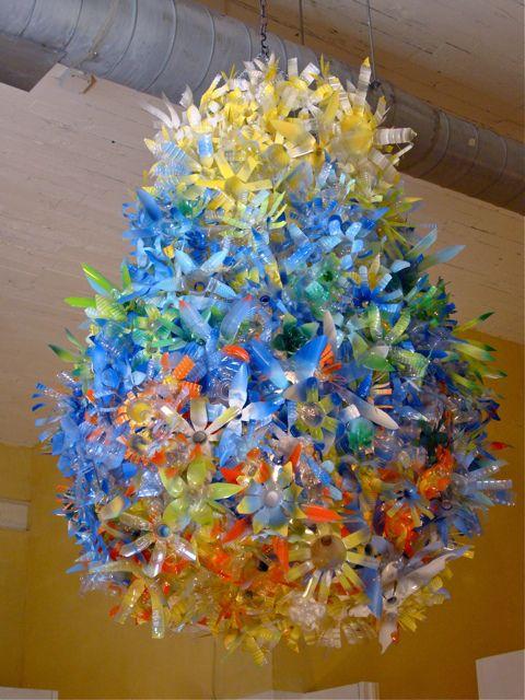 Anthropologie plastic bottle flowers flower chandelier for Recycled flower art