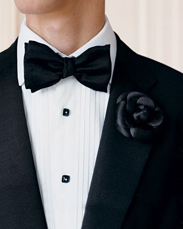 For a fashionable boutonniere, pin a black silk camellia onto your groom's lapel.