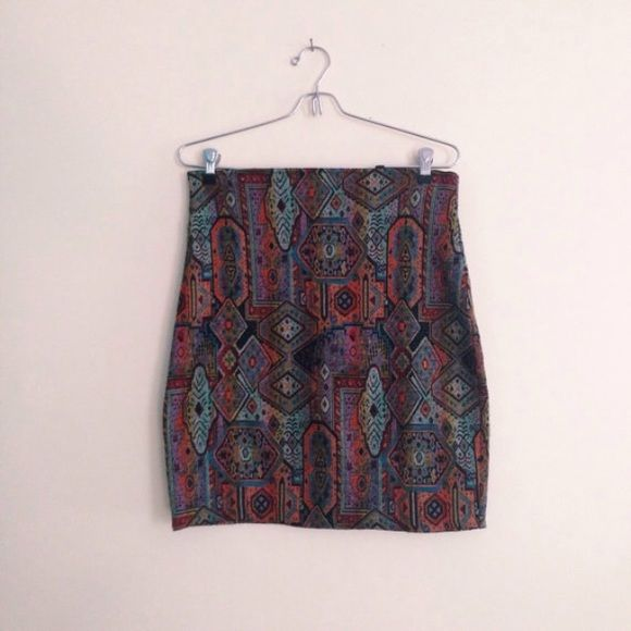 """Vintage Express Tricot Southwest Bodycon Skirt 90s bodycon pencil style skirt w/ a southwestern medallion/tapestry print.  Back zipper.  Slightly textured, stretchy lighter weight material.  Label: Express Tricot  Size: Large - may also fit a medium since it's a fitted bodycon style.    Polyester & spandex  Made in Italy  Waist: 15""""   Hips: 18""""  Length: just over 20""""    in very good vintage condition. Free of tears, holes.  Some minor pilling along the sides. 🚫No trades or lowball offers…"""