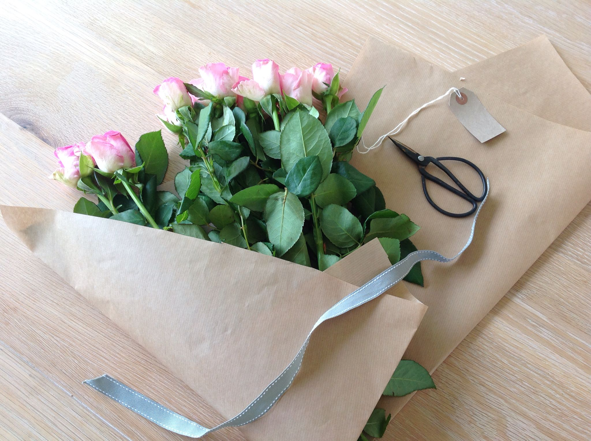 Pink Rose Bouquet Wrapped In Brown Paper Pod Pip Flowers