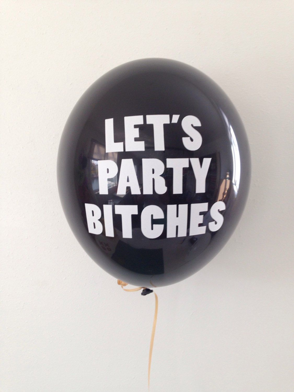 A personal favorite from my Etsy shop https://www.etsy.com/listing/245082032/lets-party-bitches-bachelorette-balloons