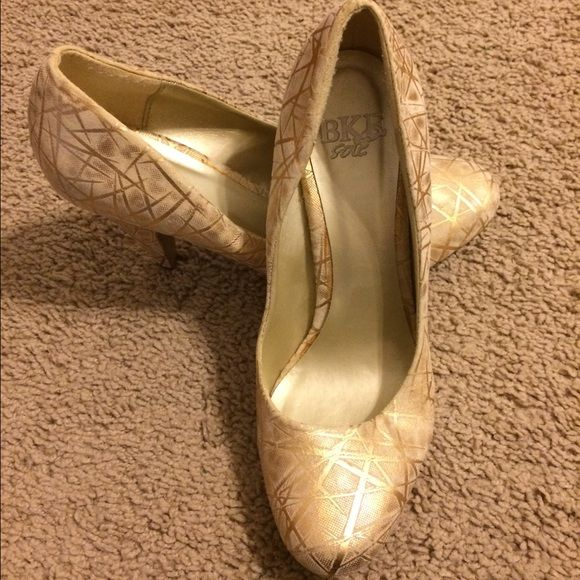 Never used Buckle gold pumps I bought these cute pumps at buckle and never wore them. They are gold and cream and made out of a soft cotton like material which makes them super comfortable. They don't have a size on them but they are just *slightly* too big for me and I'm a true 7.5 so I'm guessing they are an 8. Buckle Shoes Heels