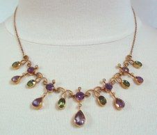 Necklace in Suffragette colors -- circa 1915, amethysts, peridots and pearls in 18K gold.