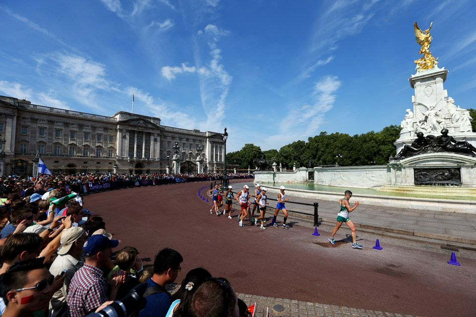 Athletes walk past the Buckingham Palace and the Queen Victoria Memorial during the Men's 50km Walk