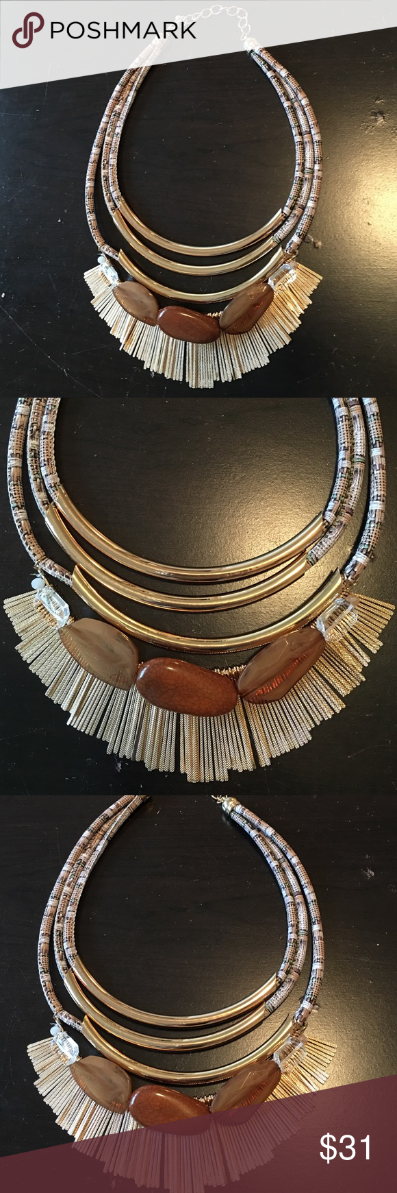 Necklace three strands. Beige / Brown Necklace three strands. Beige / Brown.  Three strands with gold tones and stones.   Never been worn Jewelry Necklaces