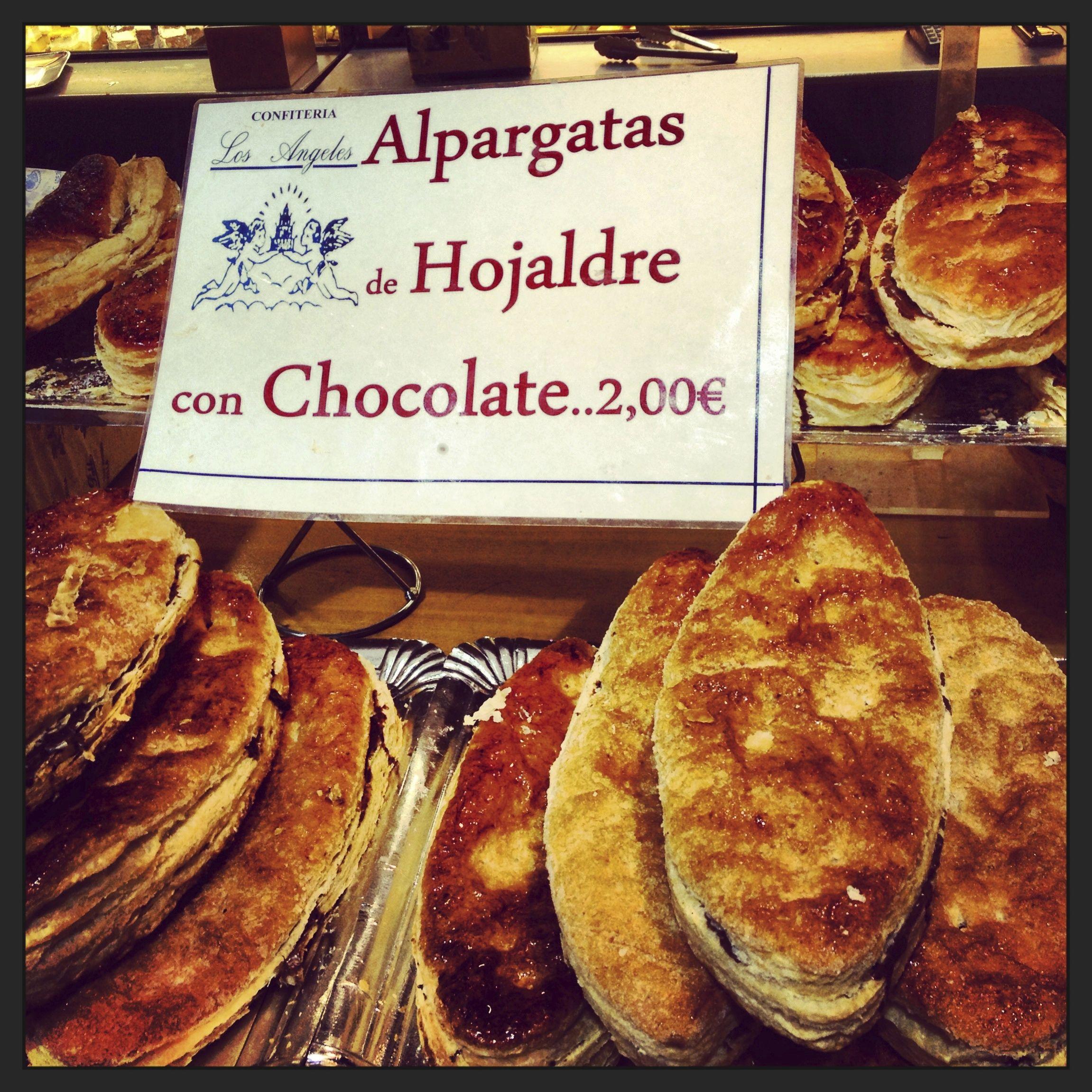 """En Sevilla, España """"Alpargatas de hojaldre con chocolate"""".Me dá risa el nombre... entro a probarlas."""