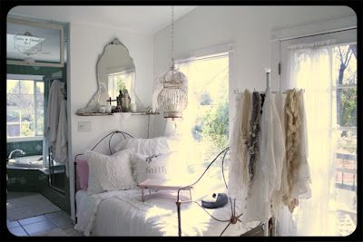 love the mirror and iron bed