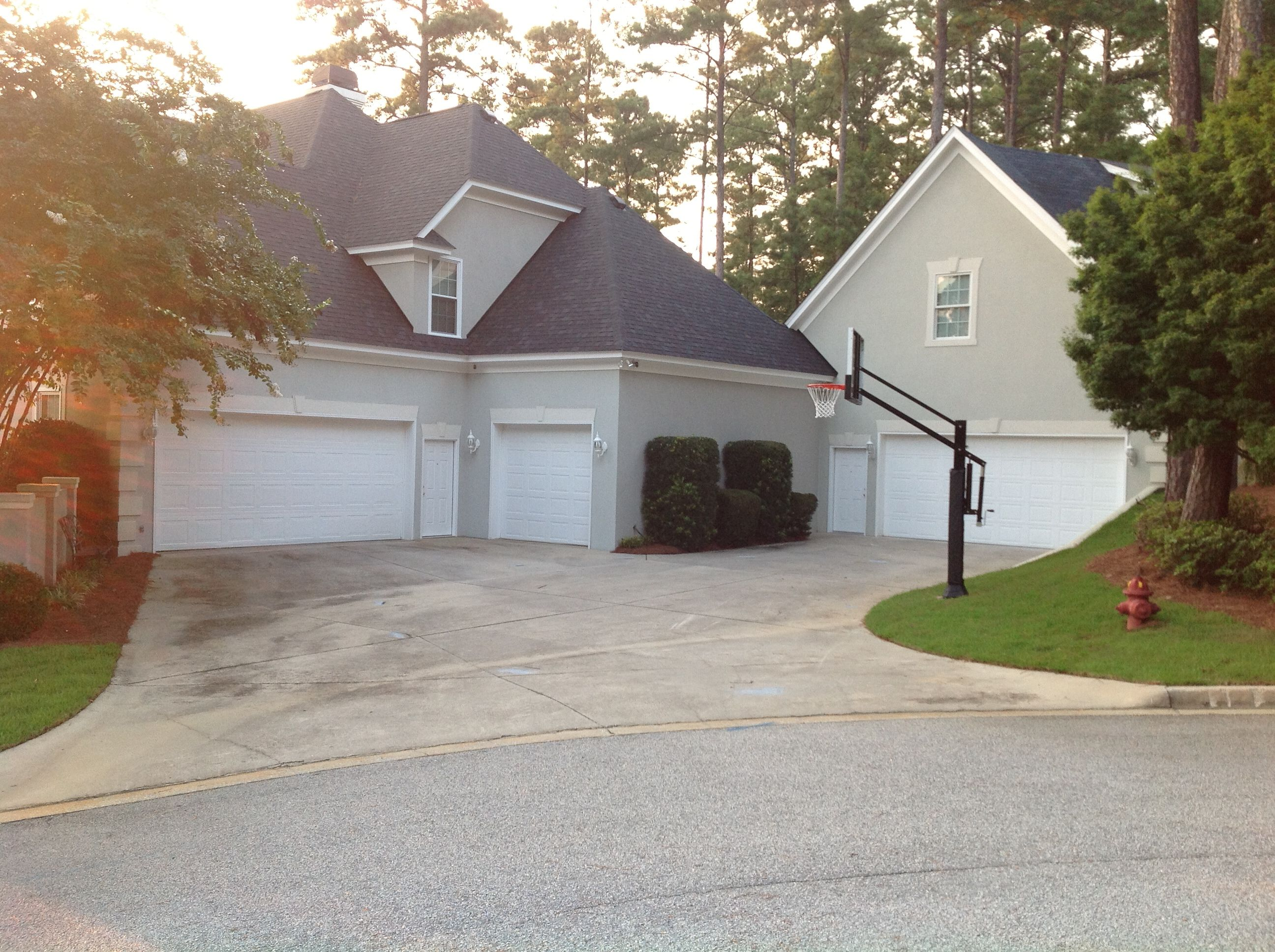 front yard hoop in the driveway the 3 car garage is definitely not