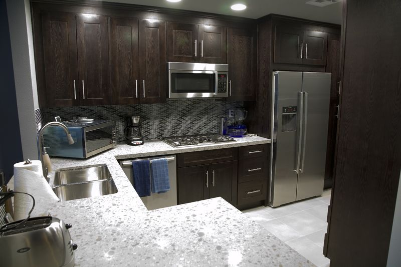 Best Dark Stained Cabinets Grey Floors And Polished Chrome 640 x 480