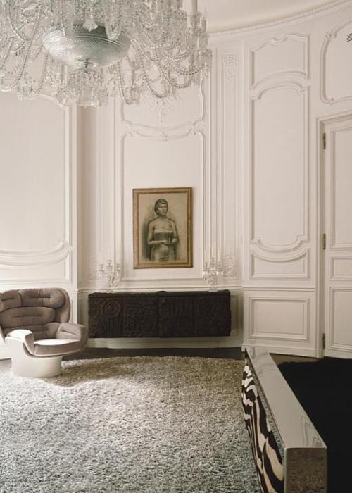 Lenny Kravitz Paris apt bedroom black white fur glam zebra chandelier 1970s chair CLASSIC