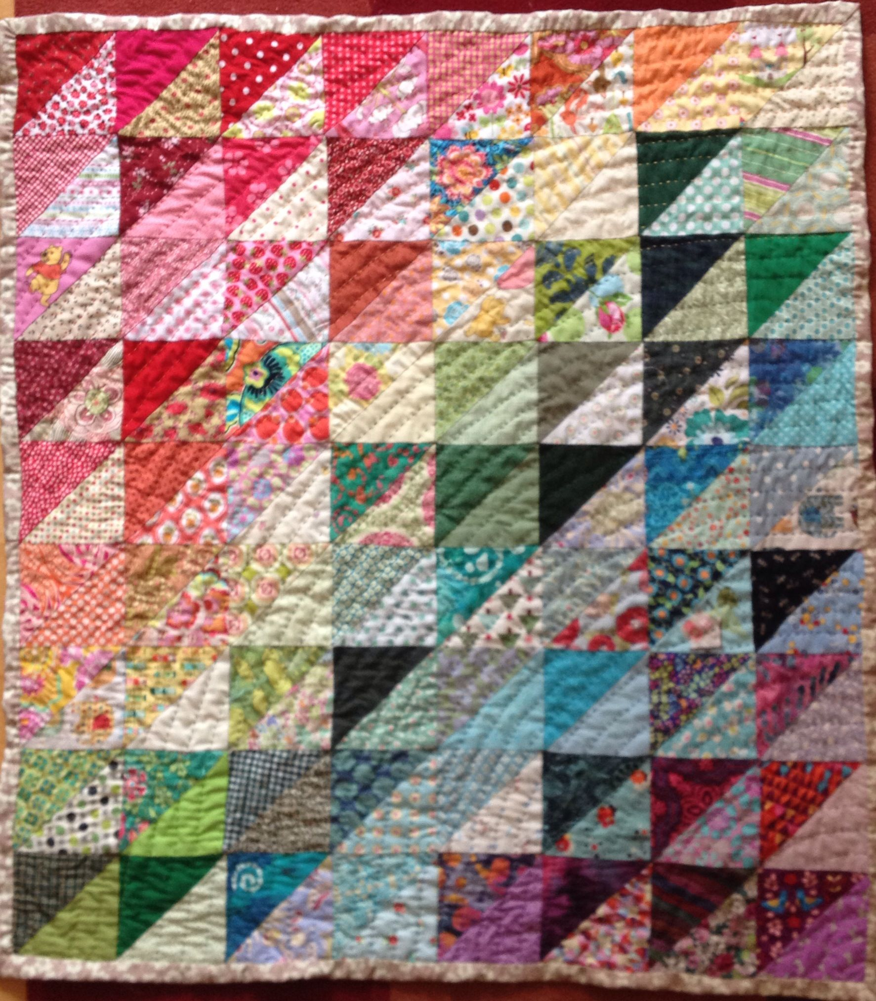 Finished scrappy rainbow baby quilt - hand pieced and hand ...