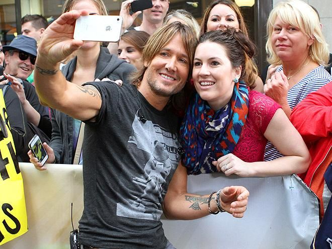 Say cheese! Keith Urban captures a sweet snapshot with a female fan during a morning performance on NBC's Today show in New York's Rockefeller Center. http://www.people.com/people/gallery/0,,20733458,00.html#30018099