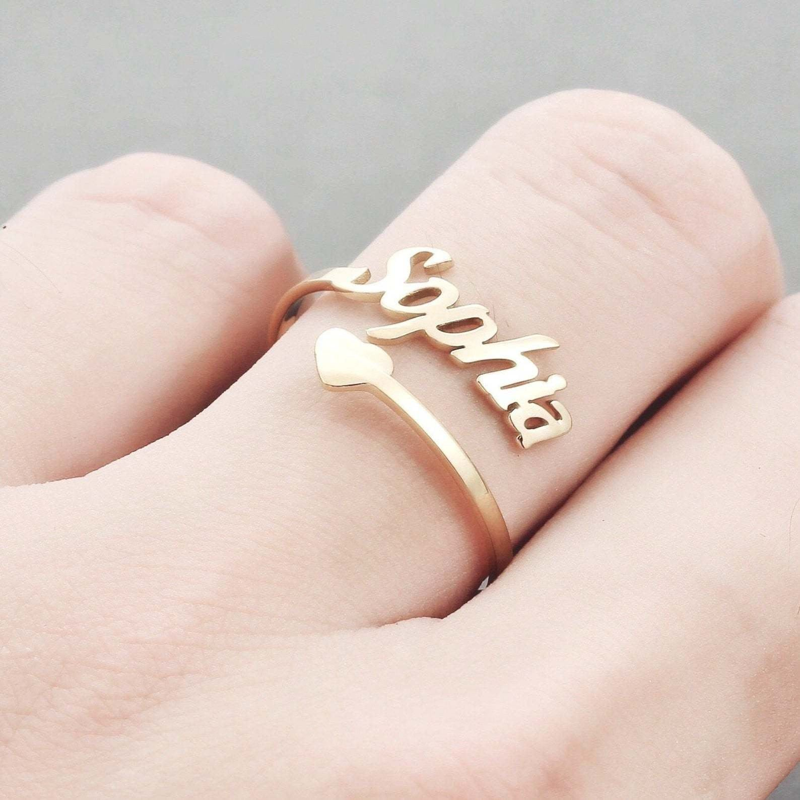 Heart Custom Name Ring in Gold / Silver / Rose Gold, Personalized Open Adjustable Ring Engagement Promise Custom Rings Customized Name . . . . . . . . . . . . . . . . . . . . . . . . . . . . . . About BisYOU BisYOU specializes in 925 sterling silver, brass, and stainless-steel personalized jewelry. We design and craft customized necklaces, bracelets, earrings, and rings for our valued customers. With 30 years in fashion jewelry and accessories, we are motivated to bring quality crafts to all of