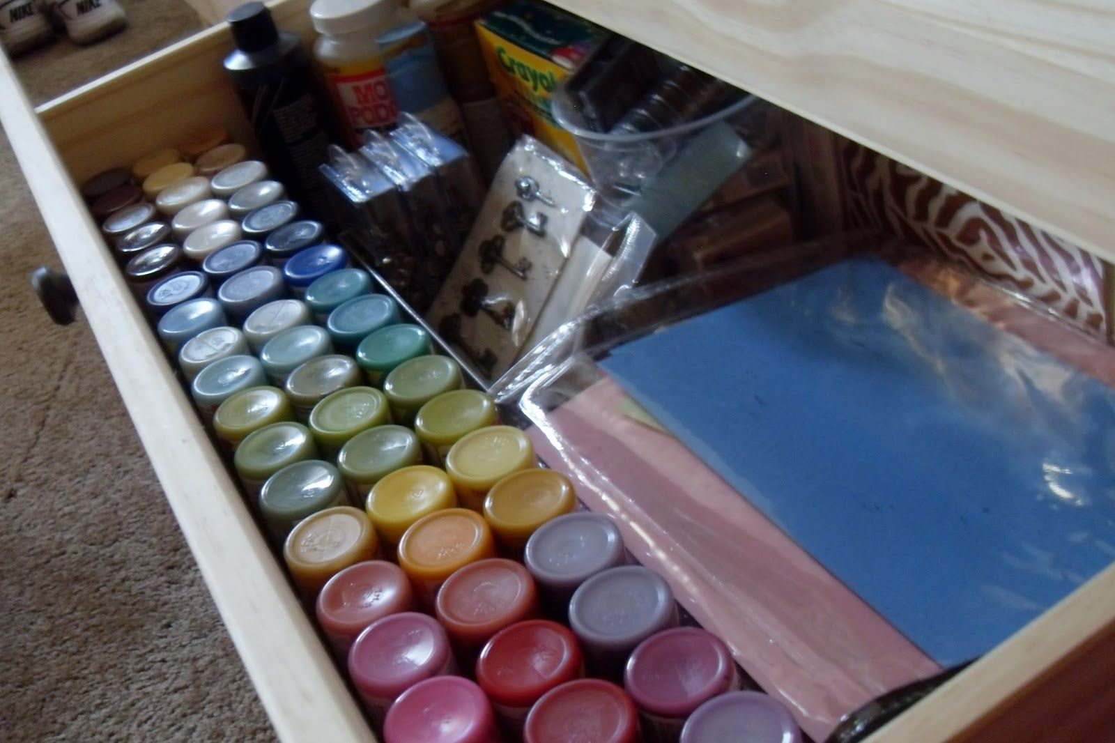 #papercraft #crafting supply #organization. Craft organization in a dresser. Use a tension rod to keep paints upright. So smart!