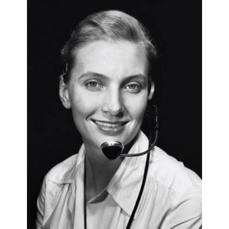 Portrait of a female customer service representative wearing a headset and smiling Canvas Art - (24 x 36)