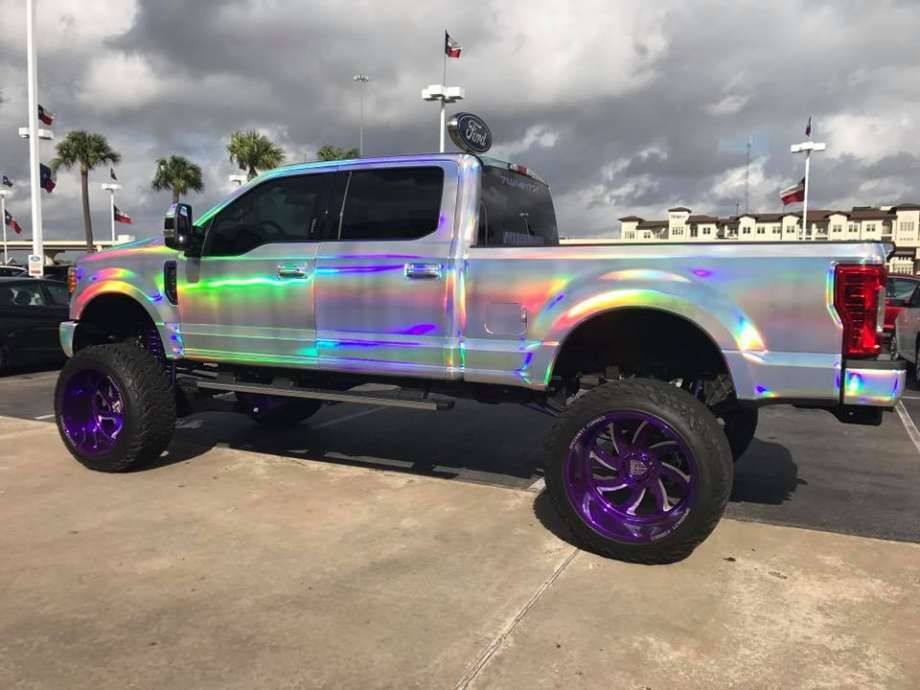 texas dealership wraps ford super duty in rainbows now it s 100 000 lifted ford trucks lifted trucks jacked up trucks lifted ford trucks lifted trucks