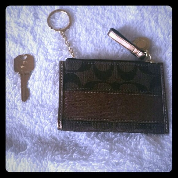 Brown AUTHENTIC Coach Keychain Wallet Never used. Key is in pic for size comparison. Perfect when you don't want to have to carry your wallet around. Coach  Bags Clutches & Wristlets
