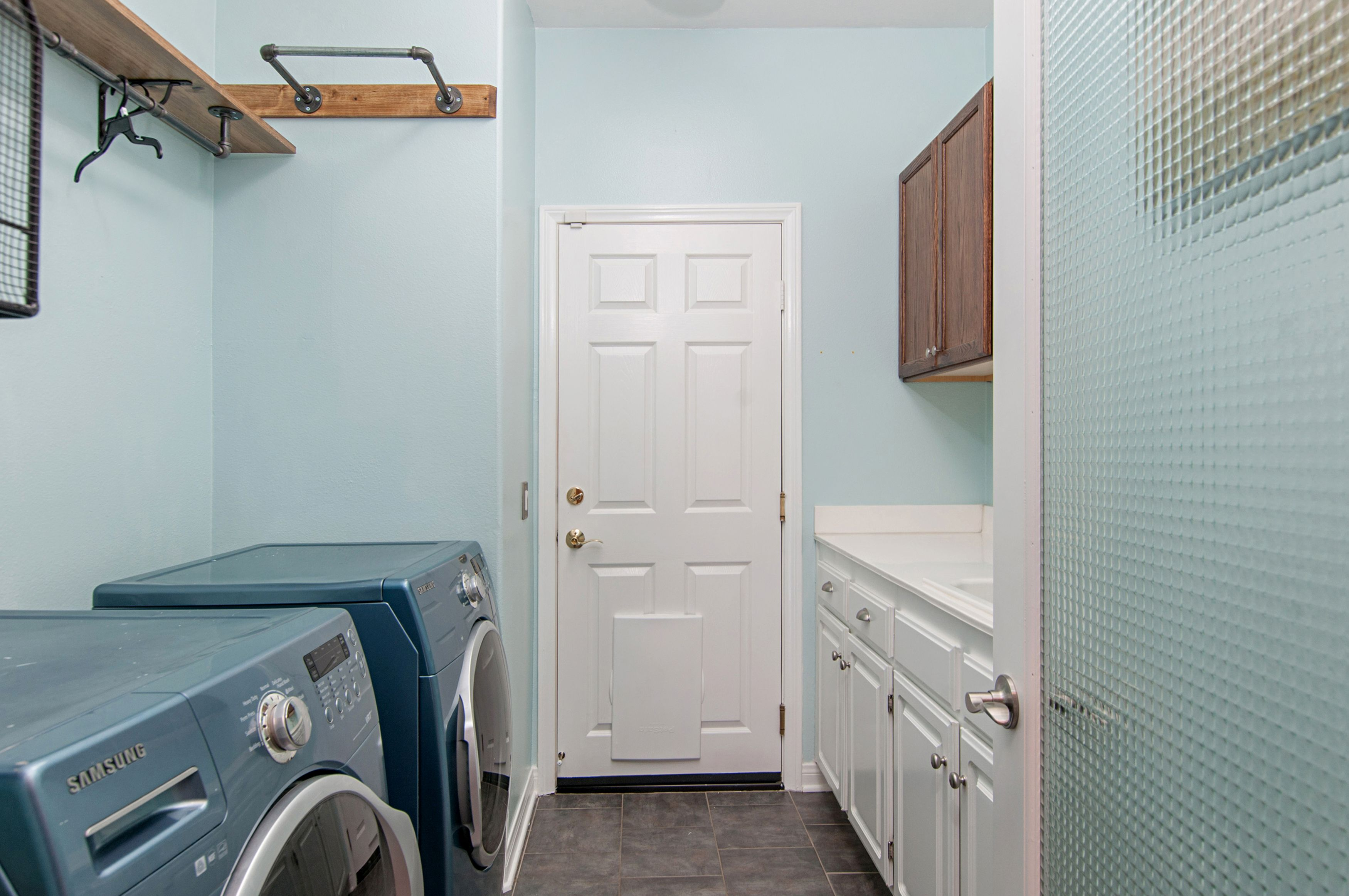 Little upgrades such as paint and wood stained shelves is all you need to make a big impact in your laundry room