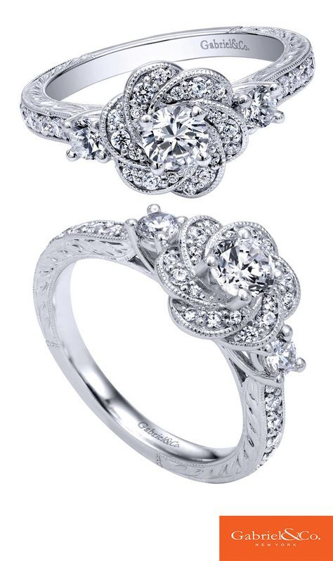 Say yes to your blossoming love with this 14k White Gold Diamond Halo Engagement Ring from Gabriel & Co. This impeccable piece has so much detail and designs that make it so unique and special. Discover your perfect engagement ring with Gabriel & Co.