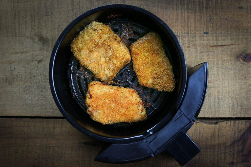 These golden fish fillets are cooked in the air fryer until crispy and delicious! Covered in a tasty crust, the fish remains soft and velvety from the inside. Ready in just 20 minutes!