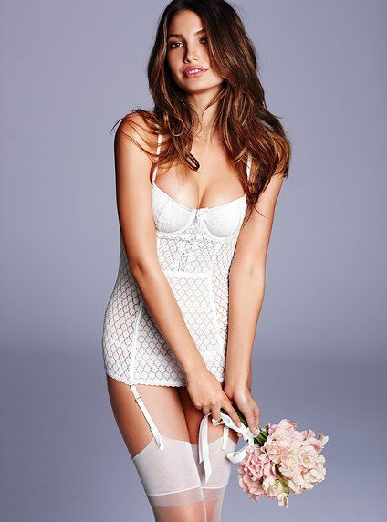 2ad86839568 Feminine lace and a sexy silhouette make for a perfect wedding day... and  night. Floral lace. Lined cups. Adjustable straps and adjustable