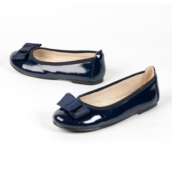 A Pazitos fall 2013 best seller: the Firefly Flat sized 28 - 38, it has a rubber sole, grosgrain ribbon on top and comes in silver, white, navy, and black. www.pazitosinc.com
