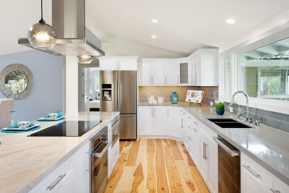 Image result for white kitchen with hickory floors kitchen
