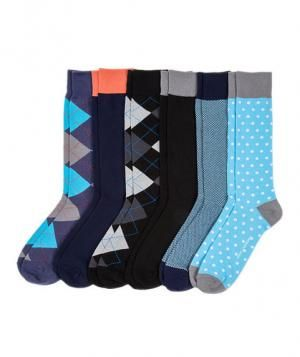 "Instead of giving him a single pair to wear on your big day, revamp his entire sock drawer. For about a hundred bucks, you can select three packs containing six pairs of socks each, in a wide variety of styles, colors, and vibes (think ""Prepster,"" ""Luminary,"" and ""Exec""). Now if he could just learn to keep them together!"