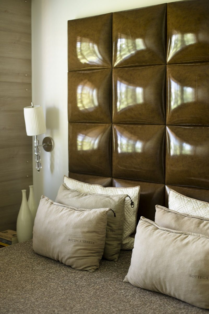 """Tranquil space: headboard """"chocolate bar"""", combined with wooden wall panelling.  LuHa Interior Design"""