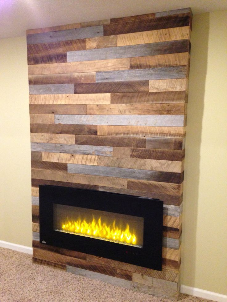 wooden fireplace screen. Using reclaimed wood and pallets with a modern electric fireplace