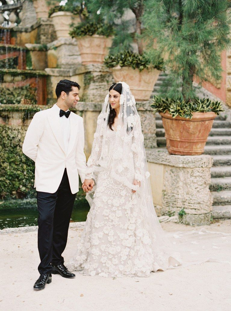 A romantic miami wedding with a garden by the sea theme with draped greenery and gorgeous details youve never seen a miami weddingor a custom naeem khan wedding dress ombrellifo Image collections