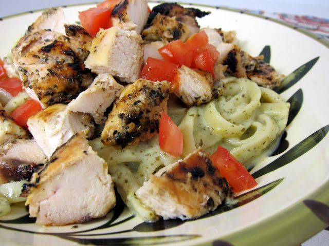 Creamy Lemon-Pesto Chicken Pasta Recipe - lemon pepper grilled chicken served over ligunie tossed in a quick creamy lemon/pesto sauce. Make the sauce while the chicken cooks - ready in under 30 minutes! We make this all the time during the summer.