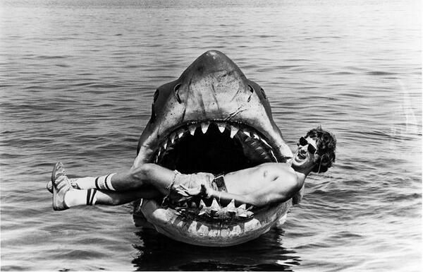 "Steven Spielberg lying in the mouth of ""Bruce the Shark"" on the set of Jaws, 1975."