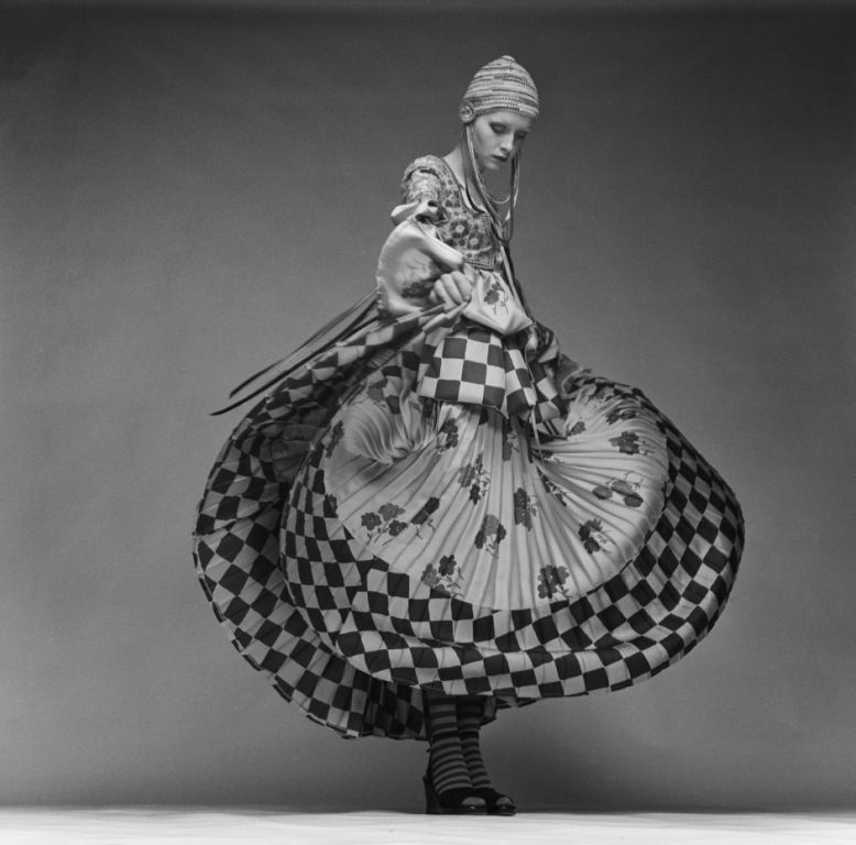 Justin de Villeneuve  Twiggy wearing a peasant-style dress by Bill Gibb with a full skirt and a knitted cap, 1970