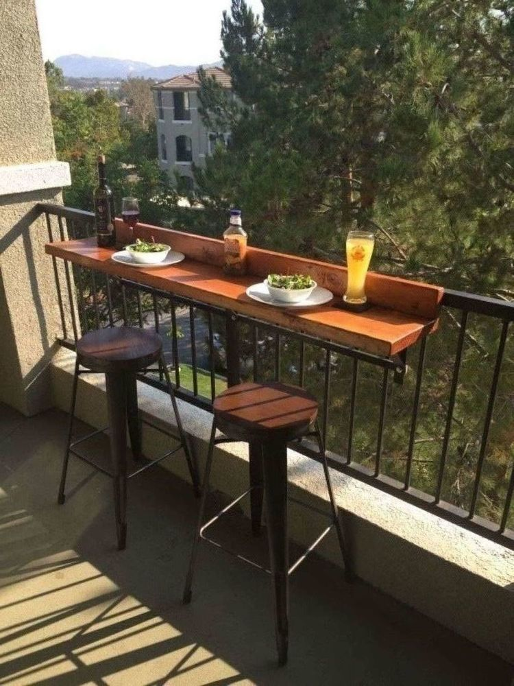 While We Were Living In Our Apartment We Decided To Add A Bar Top To Our Balcony Railing This Way We Could S Small Balcony Design Balcony Bar Apartment Patio