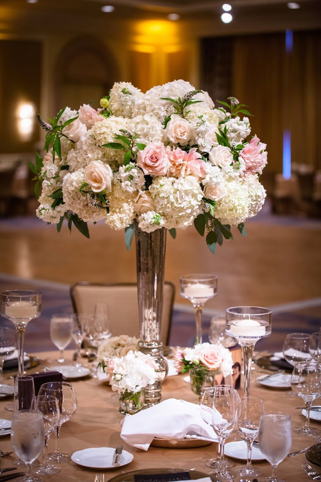 Peach ivory green floral centerpieces ballroom wedding for Floral arrangements for wedding reception centerpieces