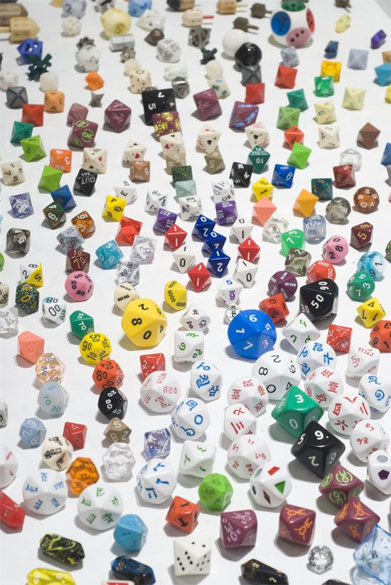 'Just A Small Portion Of Justin Michell's Enormous Dice Collection' - via Philebrity (all of these games! what could they all be?!)