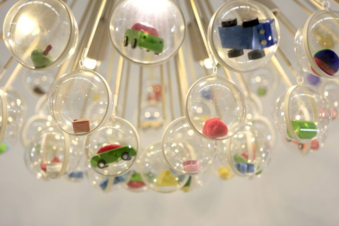 The Capsule Lamp designed by Design Systems Ltd for Actif.  Customise with your own toys