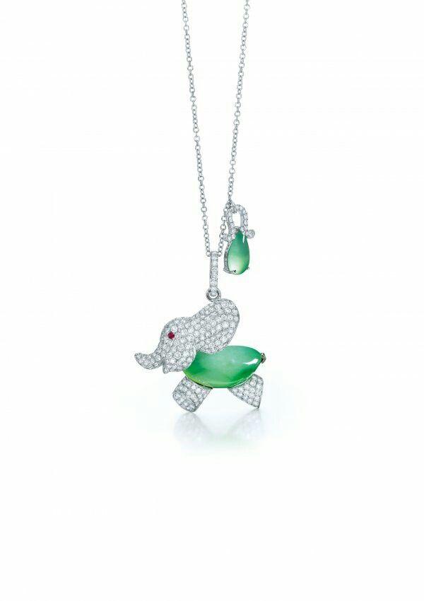 The pendant designed as a pavset diamond elephant with ruby eye