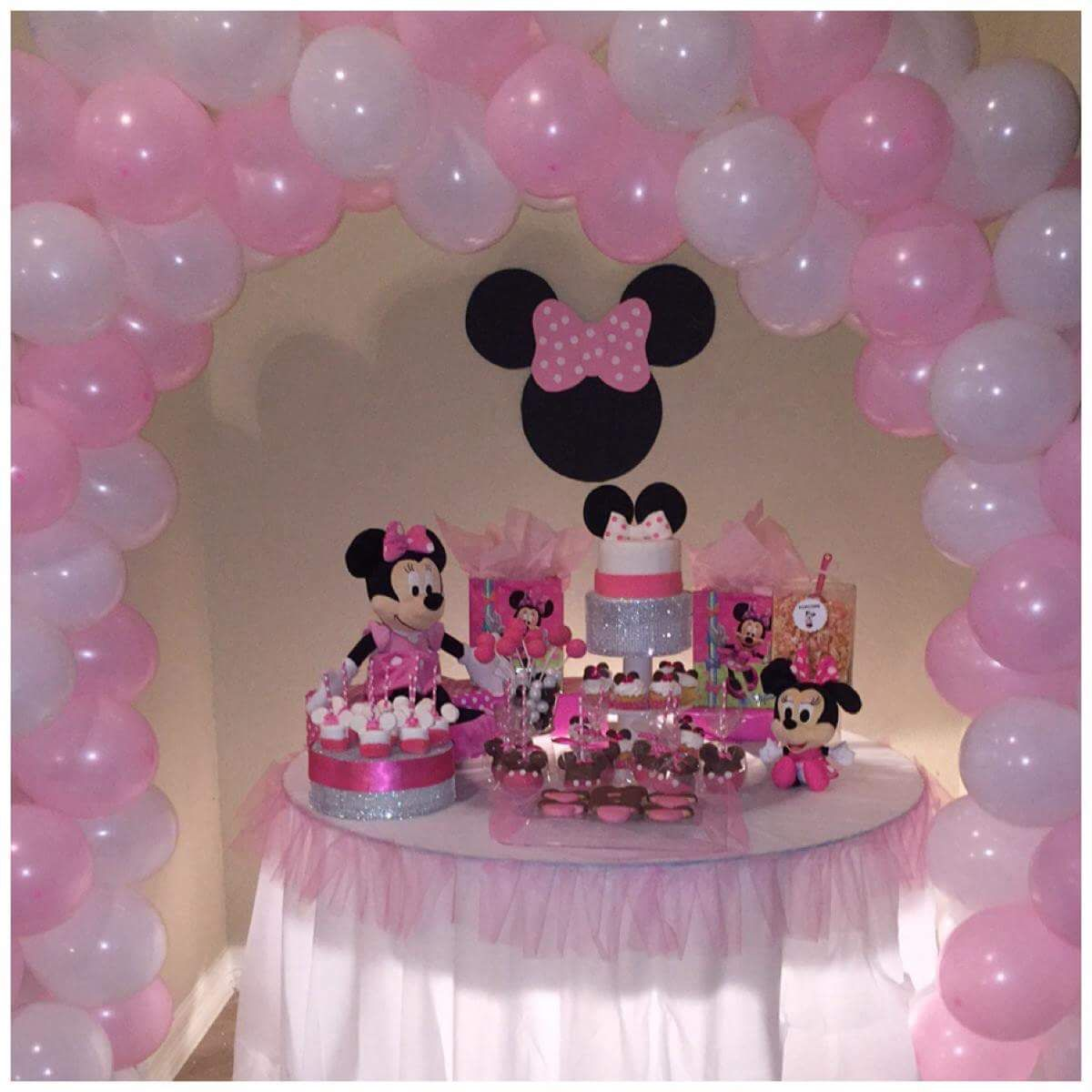 Minnie Mouse Party Table and Pink and White Balloon Arch by The